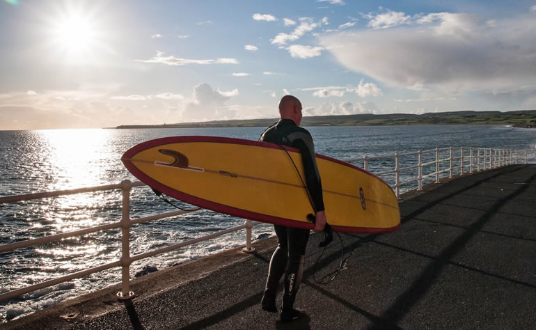 Surfer on Lahinch Seafront